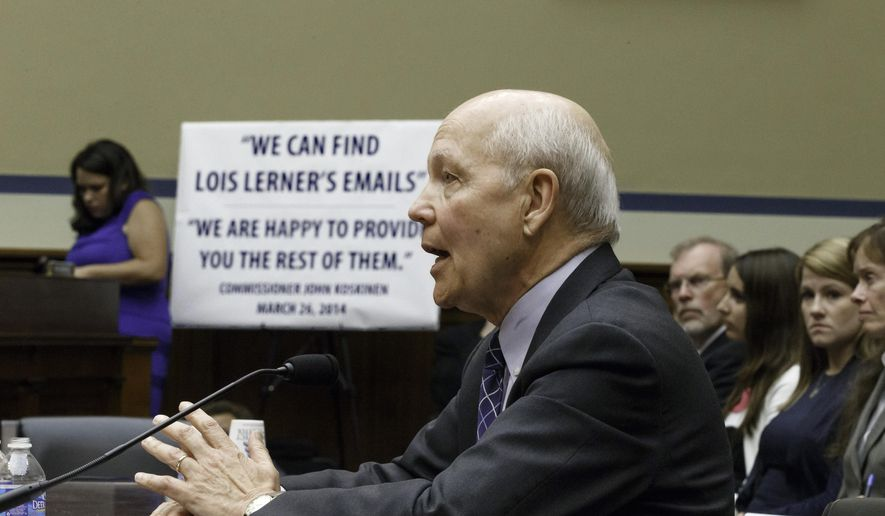 This June 23, 2014, file photo shows Internal Revenue Service Commissioner John Koskinen testifying under subpoena before the House Oversight Committee as lawmakers continue to probe whether tea party groups were targeted by the IRS on Capitol Hill in Washington. (AP Photo/J. Scott Applewhite) ** FILE **