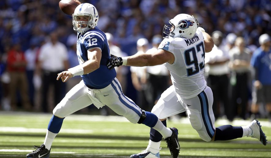 Tennessee Titans defensive tackle Mike Martin chase Indianapolis Colts quarterback Andrew Luck during the first half of an NFL football game in Indianapolis, Sunday, Sept. 28, 2014. (AP Photo/AJ Mast)