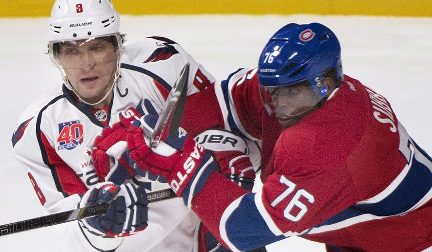 Montreal Canadiens' P.K. Subban, right, defends against Washington Capitals' Alex Ovechkin during the first period of an NHL hockey preseason game Sunday, Sept. 28, 2014, in Montreal. (AP Photo/Graham Hughes)