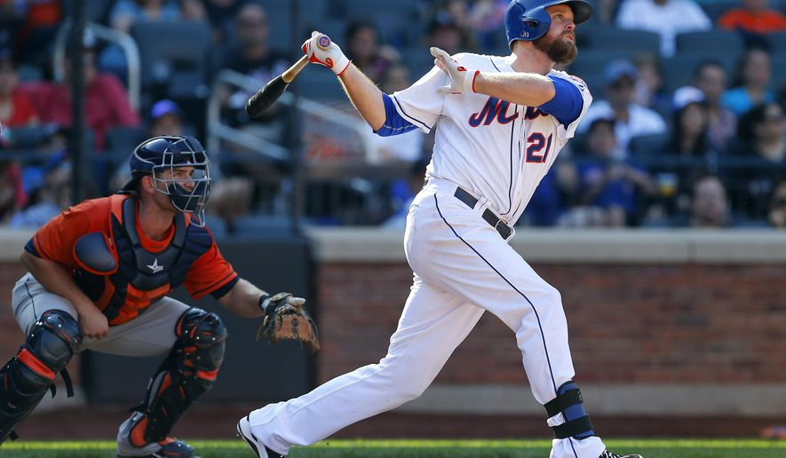 New York Mets Lucas Duda (21) hits a two run home run during the eighth inning against Houston Astros in an inter-league baseball game against the Houston Astros, Sunday, Sept. 28, 2014 at Citi Field in New York. The Mets defeated the Astros 8-3. (AP Photo/Rich Schultz)