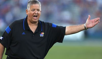 Kansas head coach Charlie Weis argues with an official after a penalty was called on his team during a game against Southeast Missouri State in the second quarter of an NCAA football game Saturday, Sept. 6, 2014, in Lawrence, Kan. (AP Photo/Ed Zurga)