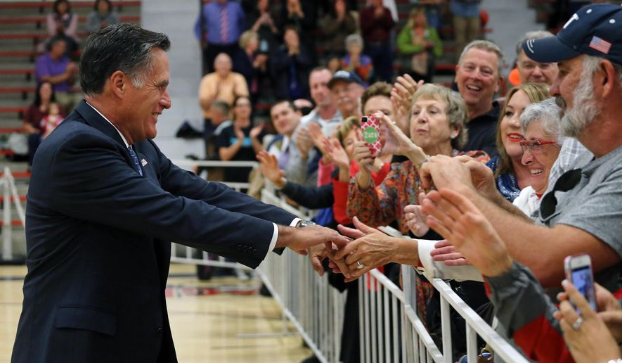 Former Republican presidential candidate Mitt Romney shakes hands with supporters following a political rally for Republican candidate for Colorado Governor Bob Beauprez, at Heritage High School, in the Denver suburb of Littleton, Colo., Monday, Sept. 29, 2014. Romney criticized Colorado Democratic Gov. John Hickenlooper during a rally in which he cheered on GOP candidates for governor and Congress. (AP Photo/Brennan Linsley)