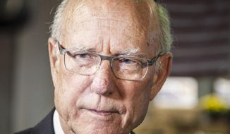 U.S. Sen. Pat Roberts speaks to reporters during a fundraising luncheon with former Florida Governor Jeb Bush as featured speaker in Wichita, Kan., Monday, Sept. 29, 2014 in a tight Senate race that has drawn national attention. (AP Photo/The Wichita Eagle, Mike Hutmacher)