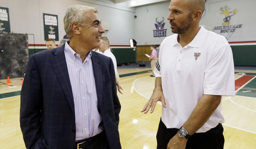 Milwaukee Bucks head coach Jason Kidd, right, talks to owner Marc Lasry during NBA basketball media day, Monday, Sept. 29, 2014, in St. Francis, Wis. (AP Photo/Morry Gash)