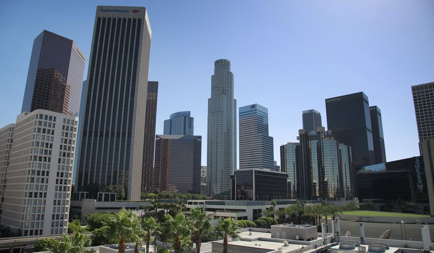 Skyscrapers line the downtown Los Angeles on Monday, Sept. 29, 2014. New skyscrapers will no longer be required to have rooftop helicopter landing pads under a change in city rules allowing alternative safety measures that will enable architects to design buildings with something other than the flat tops mandated since the 1950s. (AP Photo/Richard Vogel)