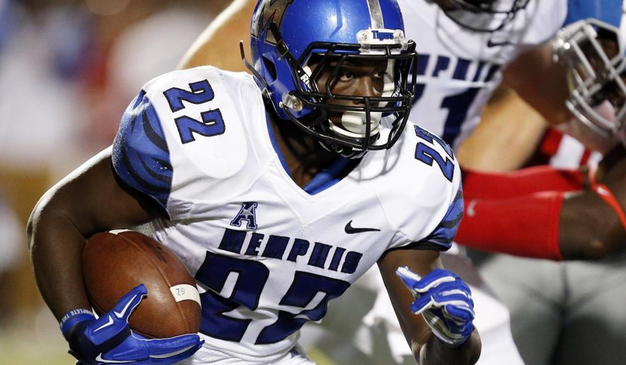 Memphis running back Doroland Dorceus (22) looks for running room in the first half of an NCAA college football game against Mississippi in Oxford, Miss., Saturday, Sept. 27, 2014.  (AP Photo/Rogelio V. Solis)