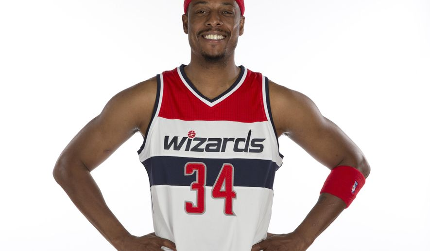 Washington Wizards forward Paul Pierce (34) poses for a photograph during NBA basketball media day at the Verizon Center in Washington, Monday, Sept. 29, 2014. (AP Photo/Carolyn Kaster)