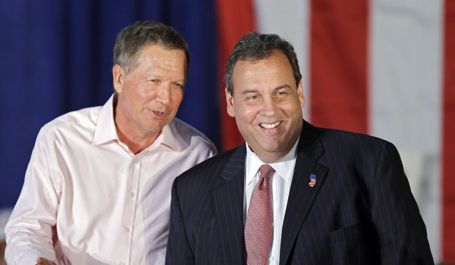 Ohio Gov. John Kasich, left, jokes with New Jersey Gov. Chris Christie at a GOP Get Out the Vote rally in Independence, Ohio, Monday, Sept. 29, 2014. (AP Photo/Mark Duncan)