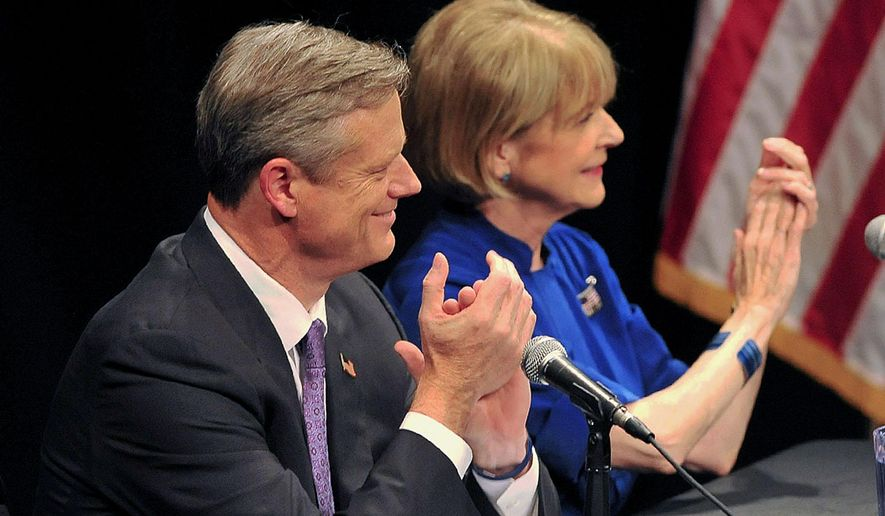Mass. Republican nominee for governor Charlie Baker, left, and Democratic nominee Martha Coakley applaud at the start of a debate in Springfield, Mass., Monday Sept. 29, 2014. (AP Photo/The Springfield Republican, Dave Roback)