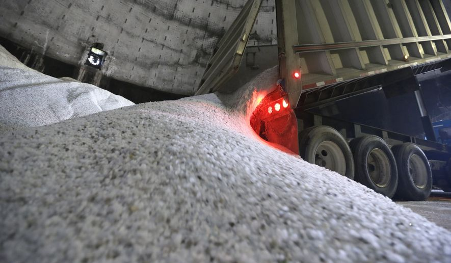 In a this Sept. 16, 2014 photo salt is unloaded at the Scio Township, Mich. maintenance yard. The rewards for surviving last year's punishing winter are tight supplies of road salt and some drastic price spikes for the commodity across much of the U.S. as the next cold season approaches. Some Midwest county road officials are facing price increases that are twice or more _ even five times _ what they paid last year if they can get it. Increases of at least 20 percent have been common in cities including Boston and Raleigh, North Carolina. (AP Photo/Carlos Osorio)