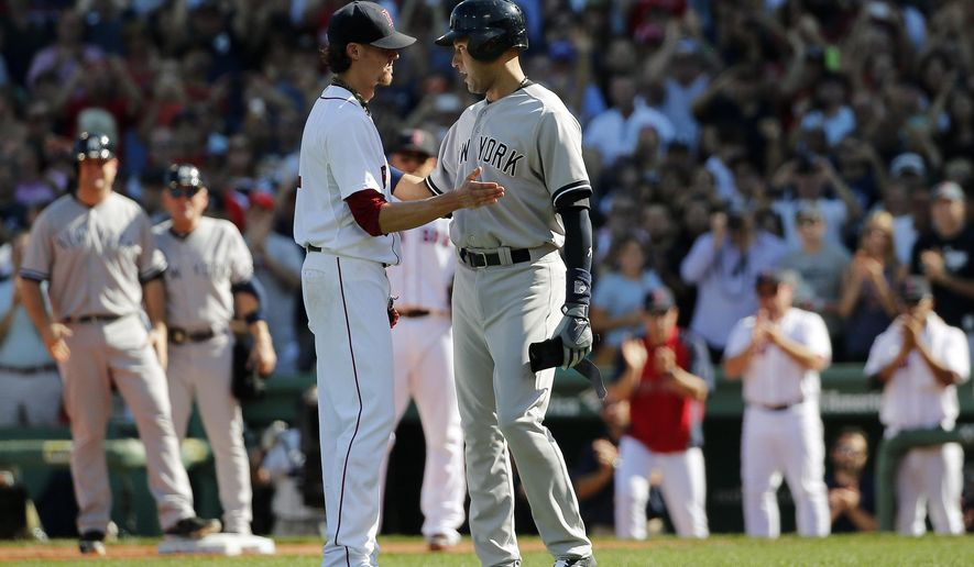 New York Yankees' Derek Jeter, right, stops to speak to Boston Red Sox starting pitcher Clay Buchholz as Jeter leaves after hitting an RBI single in the third inning of the last baseball game of his career Sunday, Sept. 28, 2014, at Fenway Park in Boston. The Yankees won 9-5. (AP Photo/Elise Amendola)