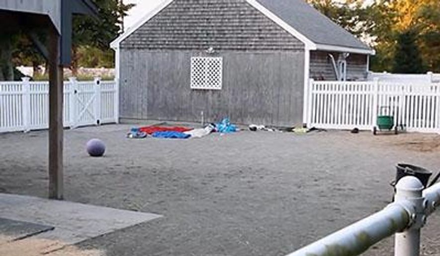 This image taken from video provided by HyannisNews.com, shows the scene following a skydiving accident Sunday, Sept. 28, 2014, in Barnstable, Mass. Barnstable police say the skydiving instructor and student died shortly after the crash near the Cape Cod Airfield. Centerville Fire Capt. Sean Greene tells WBZ-TV that the pair landed on a building outside their designated landing area. (AP Photo/HyannisNews.com, Robert Bastille) MANDATORY CREDIT; BOSTON OUT; PROVIDENCE OUT