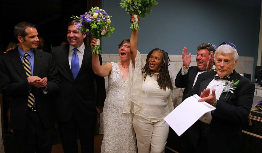FILE - In this June 25, 2014 file photo newly wed couples, from left: David Gray and Tod Martin; Miranda Duschack and Mimo Davis, and Terry Garrett and Bruce Yampolsky  celebrate after St. Louis Recorder of Deeds  announced she had officialy recorded their marriages at St. Louis City Hall. Garrett and Yampolsky watched during a hearing Monday, Sept. 29, 2014 in St. Louis as an assistant Missouri attorney general argued that state law, backed by a vote of the people, makes it clear that marriage is defined as between a man and a woman. (AP Photo/St. Louis Post-Dispatch,  David Carson, File)