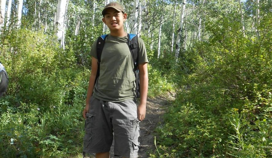 In this undated photo provided by the family of David Phan, shows their 14-year-old son who committed suicide outside a school in a Salt Lake City suburb in 2012. The family of David Phan had filed a complaint with the U.S. Department of Education and was considering a lawsuit. The American Civil Liberties Union of Utah and Granite School District announced a settlement  Monday, Sept. 29, 2014. David Phan was released early from Bennion Junior High in Taylorsville on Nov. 29, 2012 before he returned later and shot himself in front of students on pedestrian bridge near the school. His parents said he had been bullied. (AP Photo/Phan Family Photo)