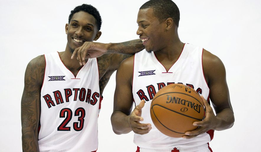 Toronto Raptors' Lou Williams, left, and Kyle Lowry laugh while posing for photos at the NBA basketball team's media day at the Air Canada Centre in Toronto, Monday, Sept. 29, 2014. (AP Photo/The Canadian Press, Darren Calabrese)