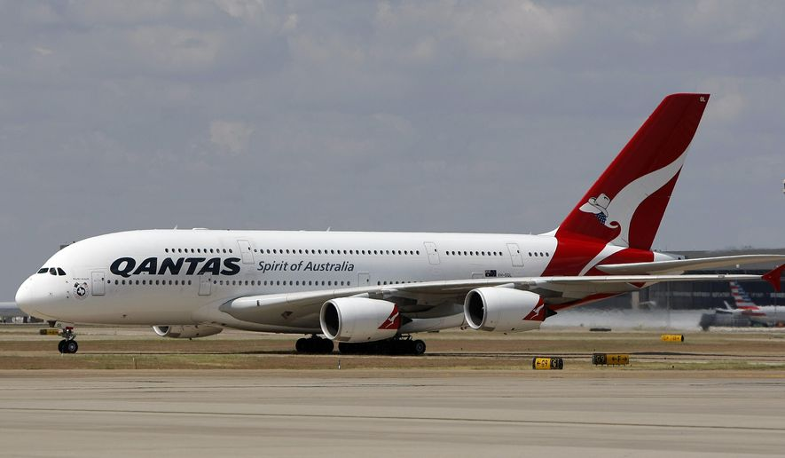 In this Sept. 29, 2014 photo released by Qantas, an Airbus A380 taxis to its gate during its inaugural landing at Dallas-Fort Worth International Airport in Texas. Qantas is putting the world's biggest passenger plane on the world's longest airline route. The Airbus A380 touched down Monday at Dallas-Fort Worth International Airport, about 15 hours after leaving Sydney, Australia, on the 8,578-mile journey. (AP Photo/Qantas, Brandon Wade)