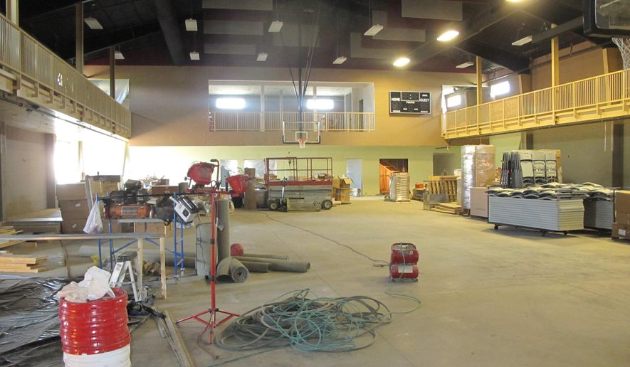 In a Sept. 23, 2014 photo, an upper-tier walking path encircles this large gym/banquet room with room for 500 that is the heart and soul of the soon-to-be-open High Plains Cultural Center in Killdeer, N.D. It will be available for events ranging from oil company training meetings to wedding receptions, and could open as soon as October, though a grand opening is set for December. (AP Photo/Bismarck Tribune, Lauren Donovan)