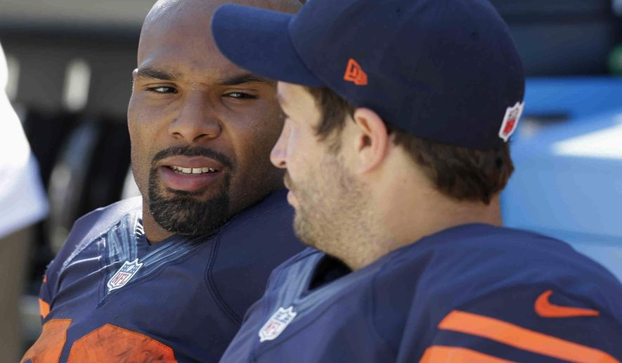 Chicago Bears running back Matt Forte (22) talks to quarterback Jay Cutler (6) on the sideline bench in the second half of an NFL football game Sunday, Sept. 28, 2014, in Chicago. The Packers won 38-17. (AP Photo/Nam Y. Huh)