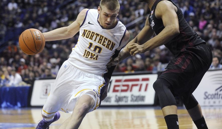 FILE - In this March 7, 2014, file photo, Northern Iowa's Seth Tuttle (10) drives past Southern Illinois' Davante Drinkard during the first half of an NCAA college basketball game in the quarterfinals of the Missouri Valley Conference men's tournament in St. Louis. Northern Iowa's hopes for reaching the NCAA tournament rest largely on the shoulders of Tuttle, a senior forward who ranks among the nation's most underrated big men. (AP Photo/Bill Boyce, File)