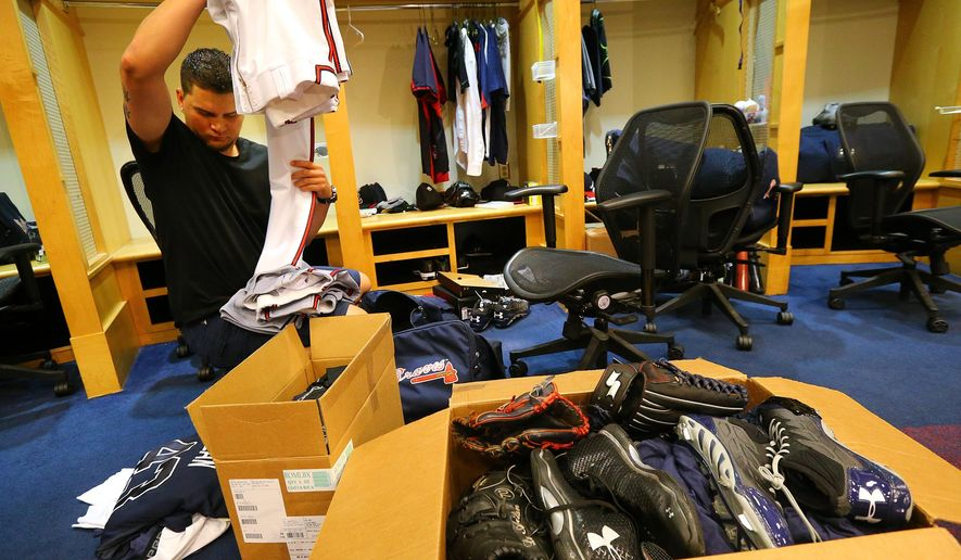 Atlanta Braves pitcher Luis Avilan packs up his locker at the baseball team's clubhouse at Turner Field Monday, Sept. 29, 2014, in Atlanta. (AP Photo/Atlanta Journal-Constitution, Curtis Compton)  MARIETTA DAILY OUT; GWINNETT DAILY POST OUT; LOCAL TELEVISION OUT; WXIA-TV OUT; WGCL-TV OUT