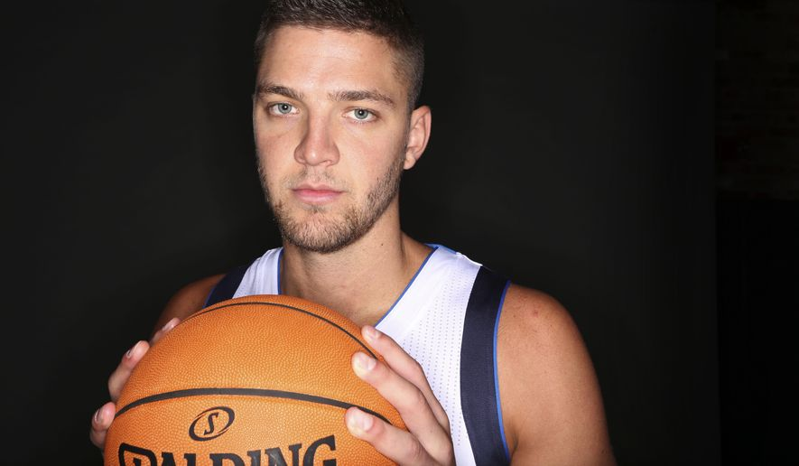 Dallas Mavericks forward Chandler Parsons poses for a photo during NBA basketball media day in Dallas, Monday, Sept. 29, 2014. (AP Photo/LM Otero)