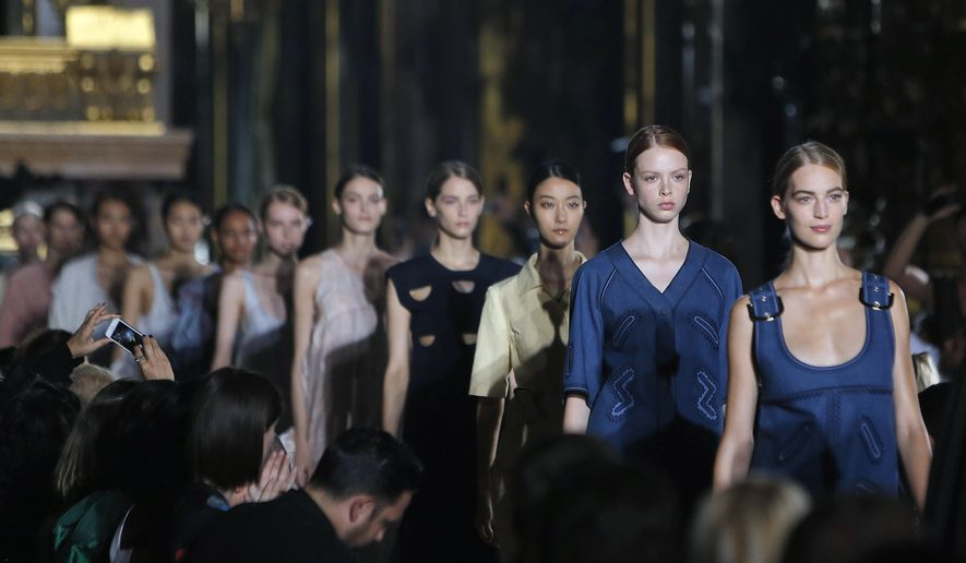Models wear creations as part of Stella McCartney's Spring/Summer 2015 ready-to-wear fashion collection presented in Paris, France, Monday, Sept. 29, 2014. (AP Photo/Thibault Camus)
