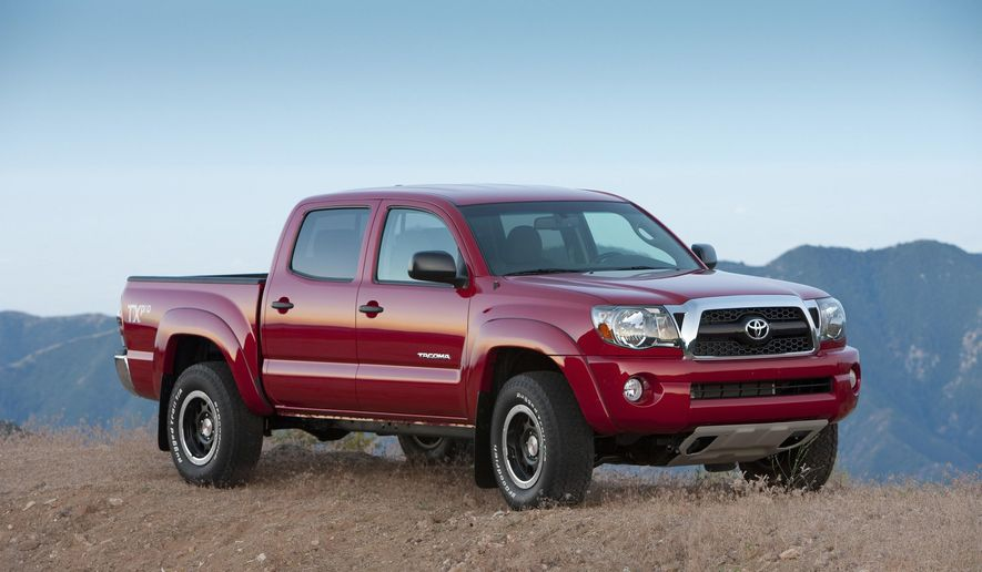 FILE - This undated file photo provided by Toyota shows the 2011 Tacoma. Toyota on Monday, Sept. 29, 2014 said it is recalling 690,000 Tacoma Four-by-Four and Pre-Runner pickups from the 2005 through 2011 model years because the rear leaf springs could break, puncture the gas tank and cause a fire. (AP Photo/Toyota, File)