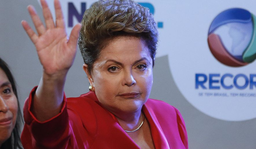 Brazil's President Dilma Rousseff, presidential candidate for re-election of the Workers Party (PT), gestures to journalists prior to a televised presidential debate in Sao Paulo, Brazil, Sunday, Sept. 28, 2014. Brazil will hold general elections on Oct. 5. (AP Photo/Andre Penner)