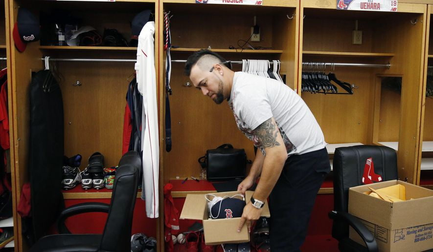 Boston Red Sox's Edward Mujica clears out his locker at Fenway Park in Boston, Monday, Sept. 29, 2014. A year after winning their third World Series in 10 years, the Red Sox wrapped up another last-place season as they became the first team in baseball history to go from worst to first and back to worst in three consecutive seasons. (AP Photo/Michael Dwyer)