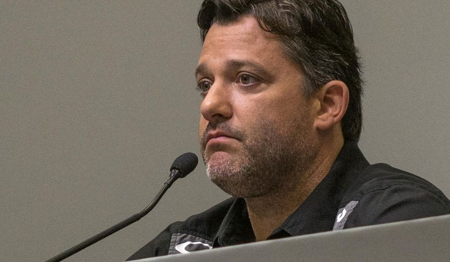NASCAR driver Tony Stewart listens during a news conference at Stewart-Haas Racing Monday, Sept. 29, 2014, in Kannapolis, N.C.  (AP Photo/The Charlotte Observer, Mark Hames) MAGS OUT; TV OUT; NEWSPAPER INTERNET ONLY