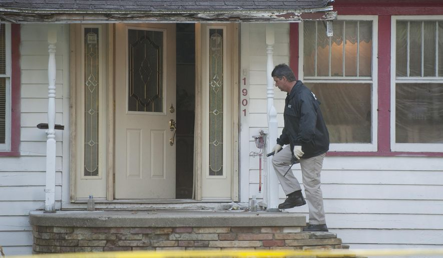 City of Jackson police investigate a possible homicide at 1901 Fourth Street in Jackson, Mich., on Monday, Sept. 29, 2014. A 20-year-old Jackson man was shot and killed in the 1900 block of Fourth Street early Monday morning, police said. (AP Photo/The Citizen Patriot, J. Scott Park)
