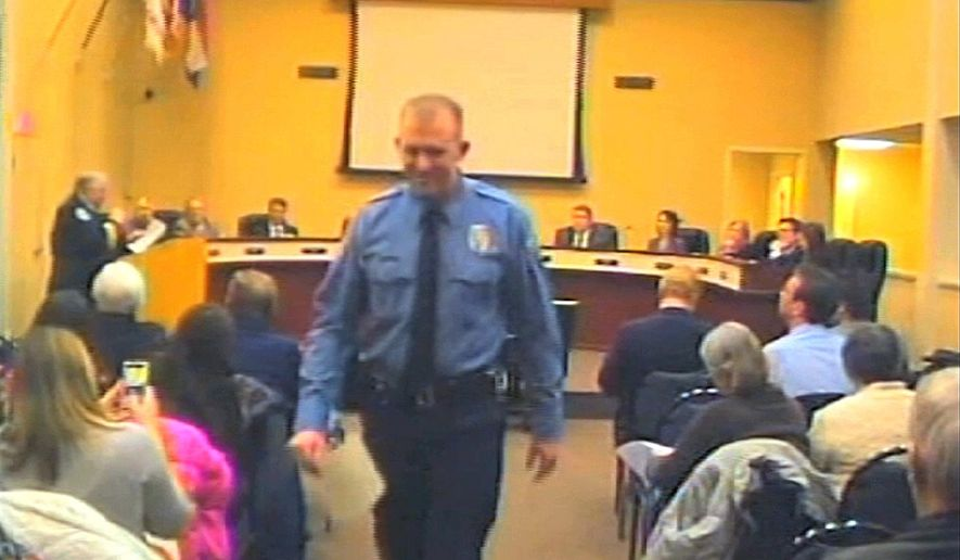 FILE - In this  Feb. 11, 2014 file image from video provided by the City of Ferguson, Mo., officer Darren Wilson attends a city council meeting in Ferguson.  Police identified Wilson, 28, as the police officer who shot Michael Brown on Aug. 9, 2014 in the St. Louis suburb. The incident sparked racial unrest and numerous protests, including some that turned violent. (AP Photo/City of Ferguson, File)