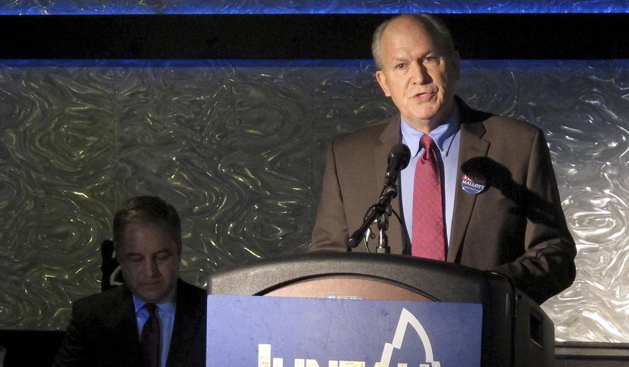 Independent gubernatorial candidate Bill Walker speaks during a debate with Republican Gov. Sean Parnell, seated at left, on Monday, Sept. 29, 2014, in Juneau, Alaska. Walker and Parnell clashed on state spending and a gas line project. (AP Photo/Becky Bohrer)