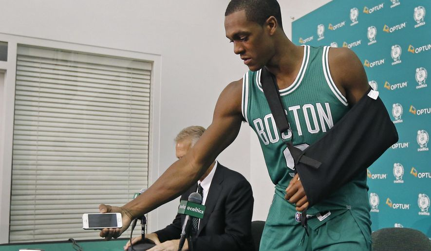 Boston Celtics guard Rajon Rondo picks up his cellphone after taking questions from reporters during NBA basketball media day in Waltham, Mass., Monday, Sept. 29, 2014. (AP Photo/Elise Amendola)