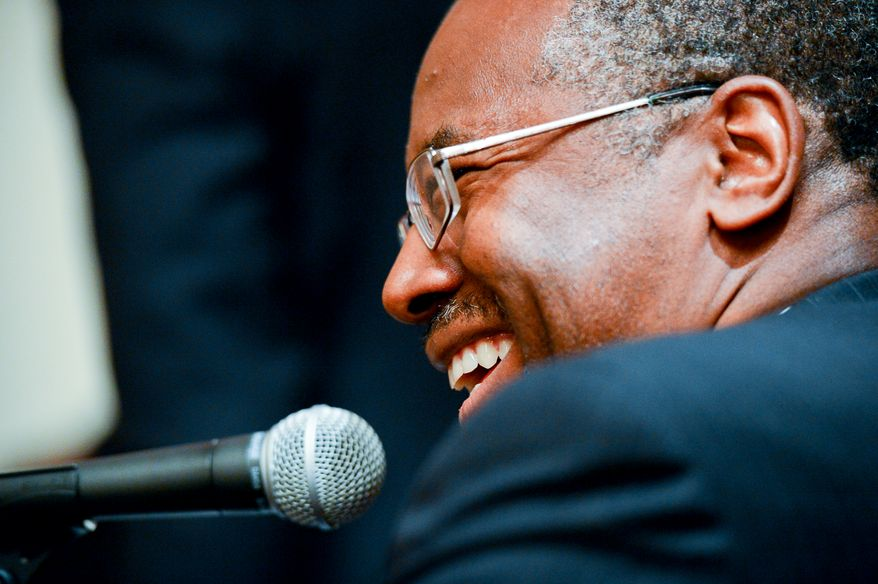 Dr. Ben Carson is interviewed by a radio station after speaking at the National Security Action Summit II held at the Marriott Wardman Hotel, Washington, D.C., Monday, September 29, 2014. (Andrew Harnik/The Washington Times)