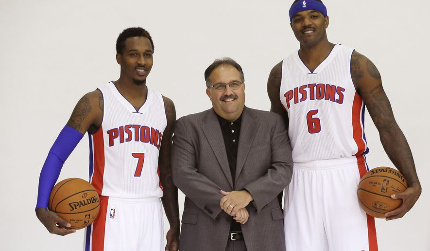 Detroit Pistons coach Stan Van Gundy stands with guard Brandon Jennings (7) and forward Josh Smith (6) during media day at the team's basketball training facility in Auburn Hills, Mich., Monday, Sept. 29, 2014. (AP Photo/Carlos Osorio)