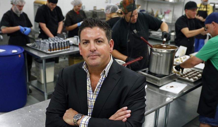 In this Sept. 25, 2014 photo, Tripp Keber, head of Denver-based Dixie Elixirs & Edibles, which makes pot-infused drinks, foods and other items, stands inside one of his edibles production kitchens at his manufacturing facility in Denver. Keber is among the entrepreneurs of the young U.S. marijuana industry who are taking another step into the mainstream, becoming political donors who use some of their profits to support cannabis-friendly candidates and ballot questions that could bring legal pot to more states. (AP Photo/Brennan Linsley)