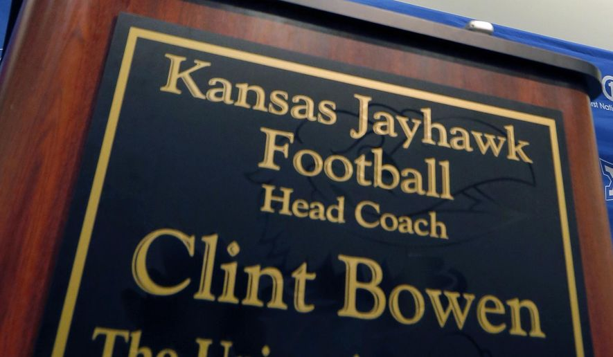 Kansas interim head football coach Clint Bowen speaks  during an NCAA college football news conference in Lawrence, Kan., Monday, Sept. 29, 2014. Bowen replaces Charlie Weis, who was fired after Saturday's 23-0 loss to Texas. (AP Photo/Orlin Wagner)