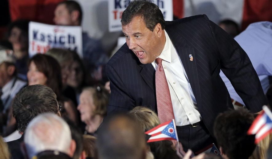 New Jersey Gov. Chris Christie greets supporters at a GOP Get Out the Vote rally with Ohio Gov. John Kasich in Independence, Ohio Monday, Sept. 29, 2014. (AP Photo/Mark Duncan)