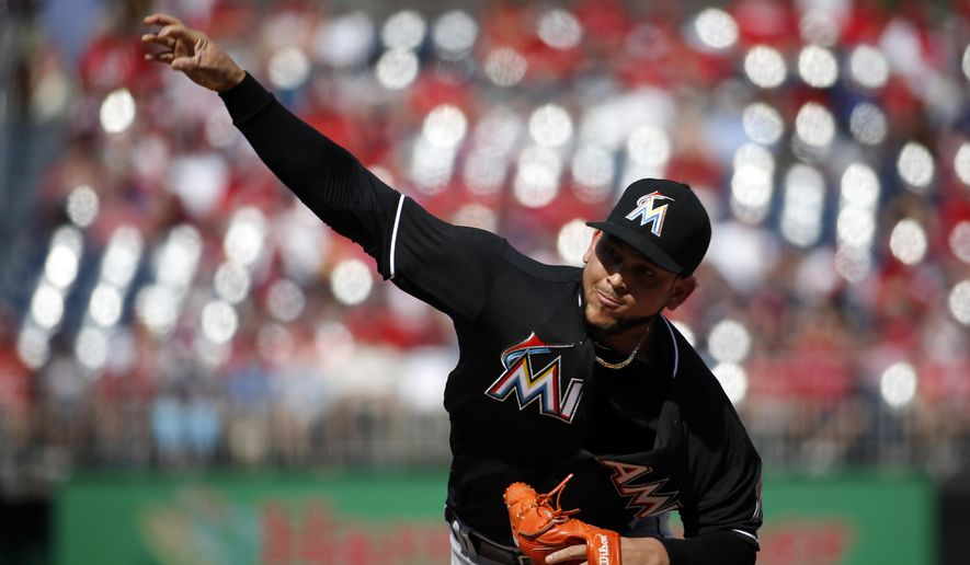 Miami Marlins starting pitcher Henderson Alvarez throws during the first inning of a baseball game against the Washington Nationals at Nationals Park, Sunday, Sept. 28, 2014, in Washington. (AP Photo/Alex Brandon)