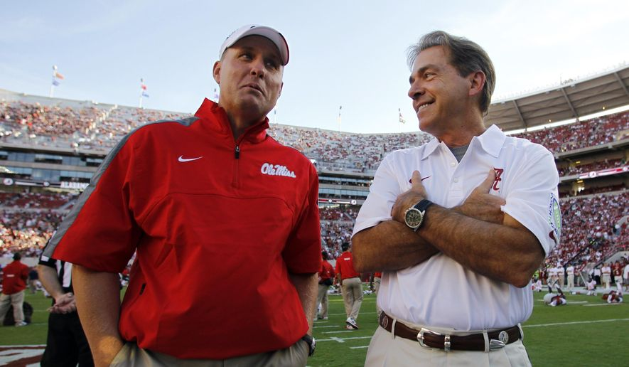 FILE - In this Sept. 28, 2013, file photo, Alabama coach Nick Saban, right, talks with Mississippi coach Hugh Freeze before an NCAA college football game in Tuscaloosa, Ala. College football turns to the SEC's Western Division on Saturday. It's the first time one division will have three league games featuring six ranked teams in one weekend: No. 3 Alabama at No. 11 Mississippi, No. 6 Texas A&M at No. 12 Mississippi State and No. 15 LSU at No. 5 Auburn.  (AP Photo/Butch Dill, File)
