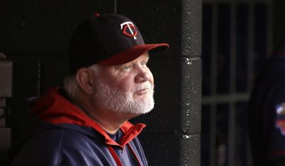 Minnesota Twins manager Ron Gardenhire is seen in the dugout during the first inning of a baseball game against the Detroit Tigers in Detroit, Saturday, Sept. 27, 2014. (AP Photo/Carlos Osorio)