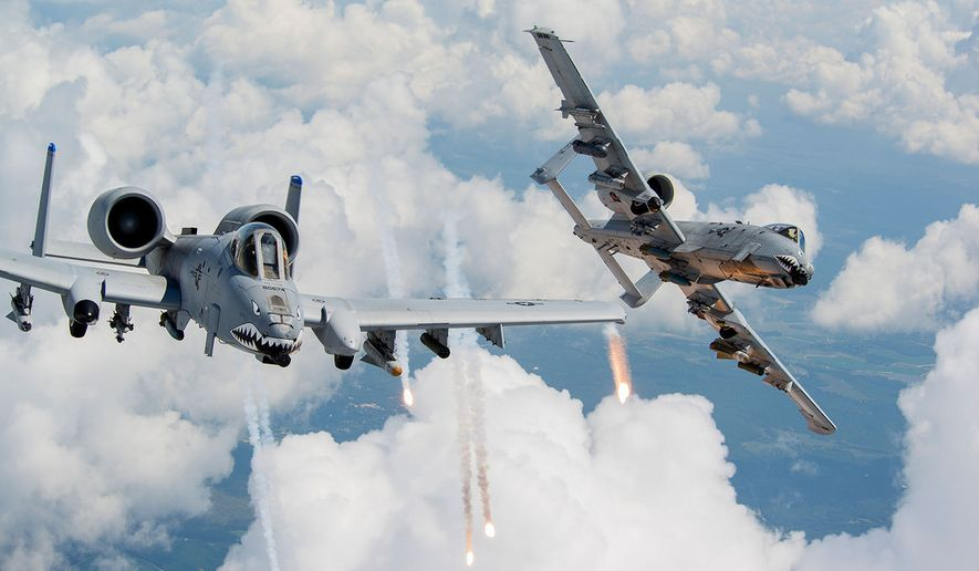 Capts. Andrew Glowa, left, and William Piepenbring launch flares from two A-10C Thunderbolt IIs Aug. 18, 2014, over southern Georgia. Both pilots are with the 74th Fighter Squadron, Moody Air Force Base, Ga. Pilots, maintainers and support Airmen ensure Moody AFB's A-10s stay mission ready for daily training sorties and deployments downrange. (U.S. Air Force photo by Staff Sgt. Jamal D. Sutter/Released) ** FILE **