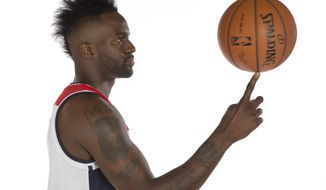 Washington Wizards forward Martell Webster (9) spins a ball on his finger as he poses for a photograph during NBA basketball media day at the Verizon Center in Washington, Monday, Sept. 29, 2014. (AP Photo/Carolyn Kaster)