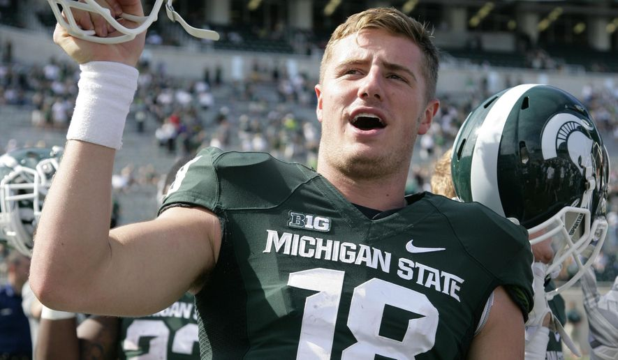 Michigan State quarterback Connor Cook celebrates following a 56-14 win over Wyoming in an NCAA college football game, Saturday, Sept. 27, 2014, in East Lansing, Mich. (AP Photo/Al Goldis)