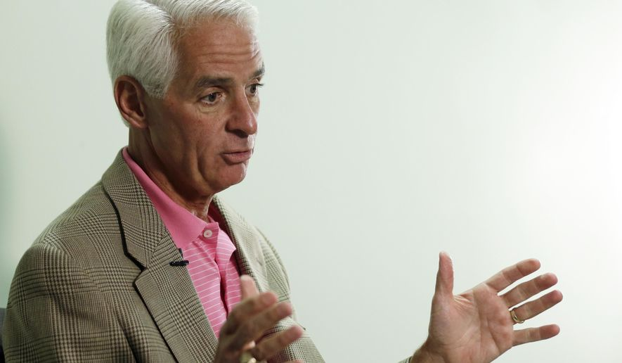 Democratic gubernatorial candidate Charlie Crist responds to a question as he sits for an interview with the Florida Associated Press staff, Tuesday, Sept. 30, 2014, in Miami. Crist, a former Republican governor of Florida, is challenging incumbent Republican Gov. Rick Scott in the November election. (AP Photo/Lynne Sladky)