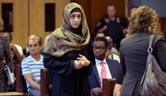 Ailina Tsarnaeva, sister of Boston Marathon bombing suspect Dzhokhar Tsarnaev, makes her appearance in Manhattan Criminal Court, Tuesday, Sept. 30, 2014, in New York. (AP Photo/New York Post, Steven Hirsch, Pool)