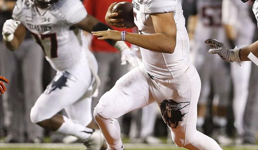 In this Sept. 25, 2014, photo, Texas Tech's Patrick Mahomes runs the ball against Oklahoma State during an NCAA college football game in Stillwater, Okla.Mahomes could see his first career start if Davis Webb is unable to play after sustaining a shoulder injury against Oklahoma State. (AP Photo/Lubbock Avalanche-Journal, Zach Long) ALL LOCAL TV OUT