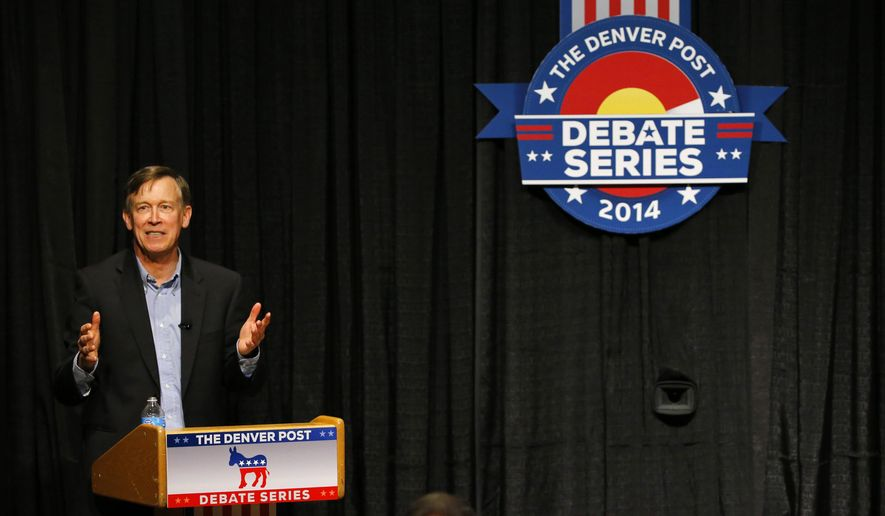 Democratic Gov. John Hickenlooper talks during a gubernatorial debate against Republican candidate Bob Beauprez, Tuesday, Sept. 30, 2014, in Denver. Hickenlooper has focused his campaign on highlighting how the state economy has improved during his time in office. (AP Photo/Jack Dempsey)