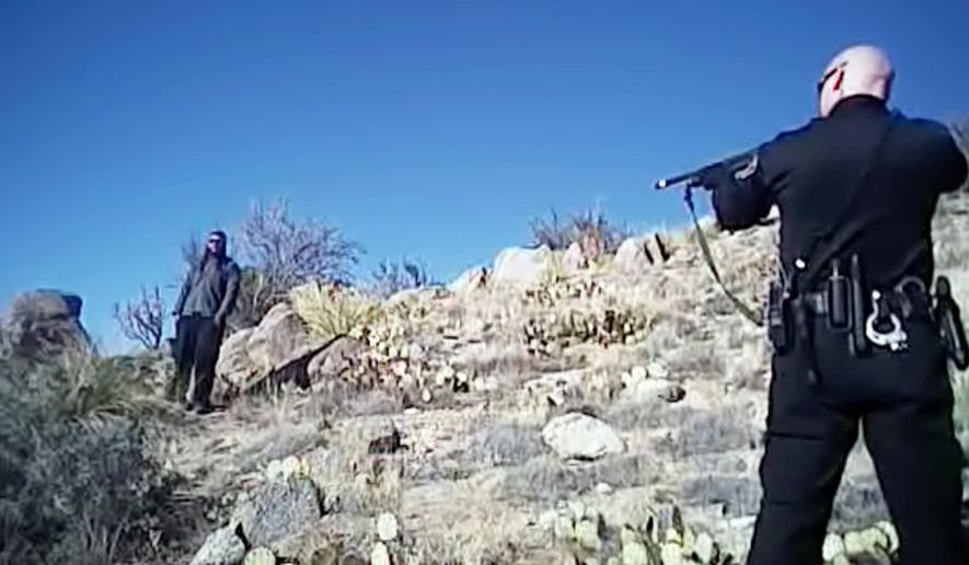 "FILE - In this file photo taken from a video shot March 16, 2014, James Boyd, 38, left, is shown during a standoff with officers in the Sandia foothills in Albuquerque, N.M., before police fatally shot him. An Albuquerque police officer's comments and behavior before a fatal shooting that sparked a protest and FBI investigation were ""completely unacceptable,"" the city's police chief said Tuesday, Sept. 30, 2014. In an interview with The Associated Press, Chief Gorden Eden said officer Keith Sandy violated department policy when he used profanity to describe a 38-year-old mentally ill homeless man. (AP Photo/Albuquerque Police Department, File )"
